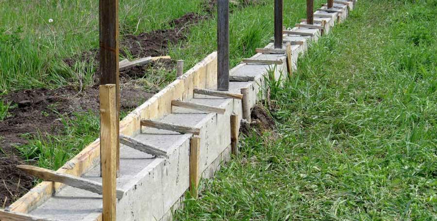 Comment réaliser les fondations d'un mur en beton?