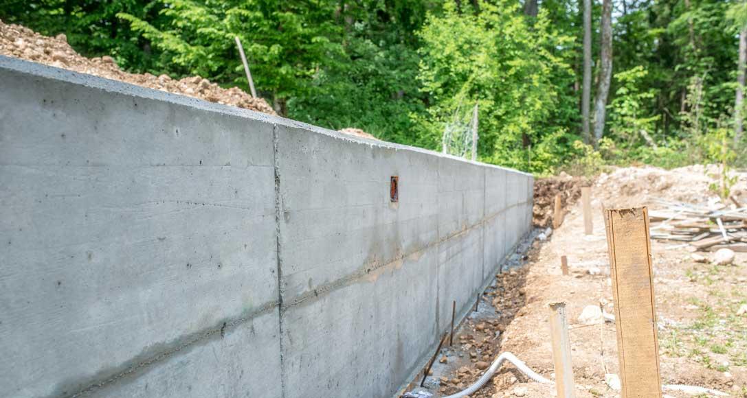 Comment faire la Fondation d'un mur de clôture?